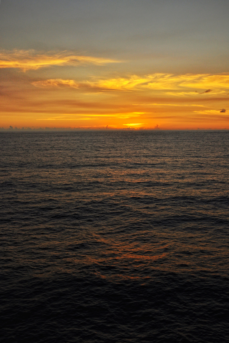 Caribbean sunset at sea